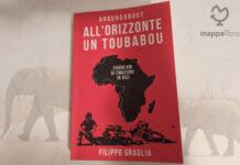 """Copertina del libro """"All'orizzonte un Toubabou. 25.000 km di emozioni in bici"""" di Filippo Graglia"""